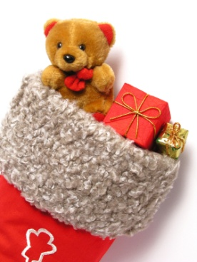 Teddy bear and gifts in a stocking