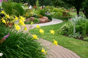Winding path through a park with flowers