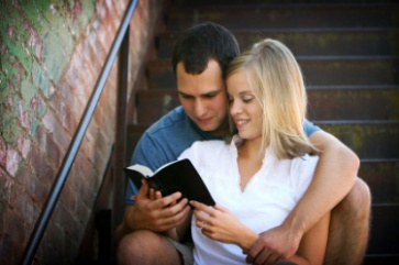 Man and women reading a bible