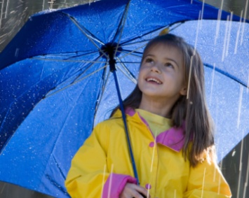 Girl In the rain with umbrella