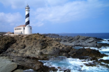 Lighthouse surrounded by water and rocks
