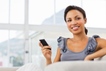 Lady texting and smiling