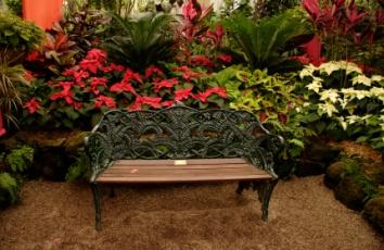 Memorial Bench in a flower garden