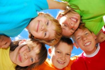 Five smiling happy kids